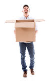 Happy man holding a box Stock Image