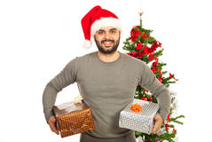 Happy man holding Christmas gifts Royalty Free Stock Images