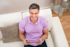 Happy man holding digital tablet Royalty Free Stock Photo