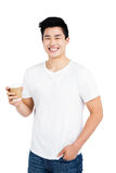 Happy man holding disposable coffee cup smiling at camera Royalty Free Stock Photography