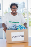 Happy man holding donation box Stock Photography