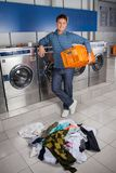 Happy Man Holding Empty Basket With Dirty Clothes Royalty Free Stock Photos