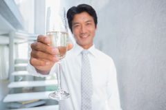 Happy man holding flute of champagne Royalty Free Stock Photos