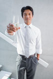 Happy man holding flute of champagne Royalty Free Stock Photo