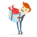 Happy man holding gift box with bow Royalty Free Stock Images