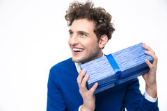 Happy man holding gift. Over white background Stock Images