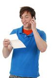 Happy man holding a greeting card Royalty Free Stock Photos