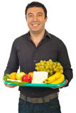 Happy man holding healthy food royalty free stock photo