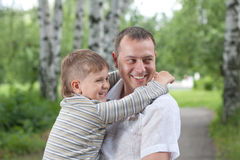 Happy man holding his son Royalty Free Stock Images