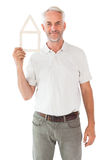 Happy man holding house outline. On white background Royalty Free Stock Photo