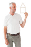 Happy man holding house outline. On white background Royalty Free Stock Photography