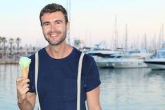 Happy man holding an ice cream Stock Photos