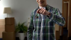 Happy man holding keys to new apartment, affordable bank lending, mortgage. Stock photo stock photo