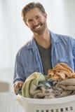 Happy Man Holding Laundry Basket Stock Images