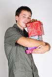 Happy Man Holding Many Gifts And Smiling Royalty Free Stock Image