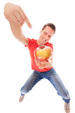 Happy man holding offering apple. Diet. Stock Images