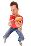 Happy man in holding offering apple. Diet health care healthy nutrition. Royalty Free Stock Photos