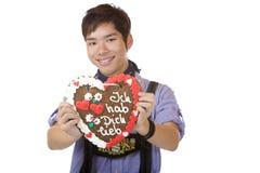 Happy man holding Oktoberfest heart Stock Photography