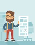 Happy man holding a paper. A Caucasian man happy standing inside his office  showing his complete paper works report on time. Achievemnet concept. A contemporary Royalty Free Stock Photos