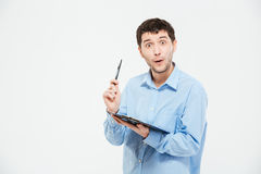 Happy man holding pen and clipbaord Stock Photos