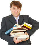 Happy man holding pile of books. Happy young man holding a pile of books Stock Image