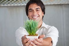 Happy Man Holding Plant Stock Photos