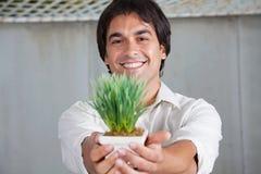 Happy Man Holding Plant stock photos