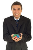 Happy man holding poker chips Stock Photo