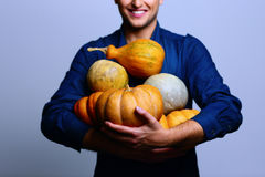 Happy man holding pumpkin Stock Photo