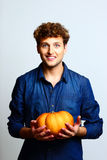 Happy man holding pumpkin Royalty Free Stock Images