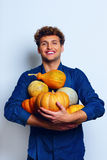 Happy man holding pumpkins Royalty Free Stock Photos