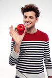 Happy man holding red apple Royalty Free Stock Image