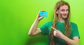 Happy man holding a retro cassette tape stock images