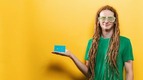 Happy man holding a retro cassette tape stock photography