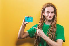 Happy man holding a retro cassette tape royalty free stock image