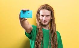 Happy man holding a retro cassette tape stock photos
