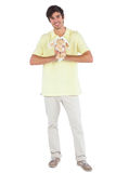 Happy man holding a sheep plush Royalty Free Stock Image