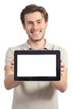 Happy man holding and showing a blank horizontal tablet screen. Isolated on a white background Stock Photo
