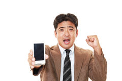 Happy man holding a smart phone Royalty Free Stock Photo