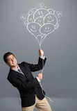 Happy man holding smiling balloons drawing Royalty Free Stock Images