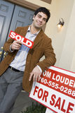 Happy Man Holding A Sold Sign Board Stock Photos