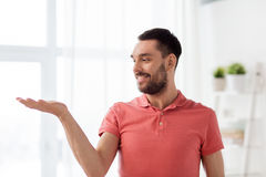 Happy Man Holding Something Imaginary At Home Stock Photos