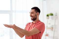 Happy Man Holding Something Imaginary At Home Royalty Free Stock Images