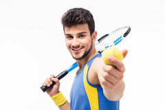 Happy man holding tennis ball and racket Royalty Free Stock Photography