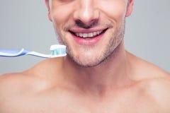 Happy man holding toothbrush Royalty Free Stock Image