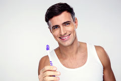 Happy man holding toothbrush Stock Photography
