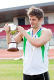 Happy man holding a trophy Stock Photography