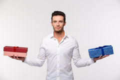 Happy man holding two gift boxes Royalty Free Stock Photo