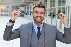 Happy man holding two pairs of glasses.  Stock Photography