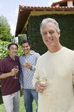 Happy Man Holding Wine Glass Stock Image